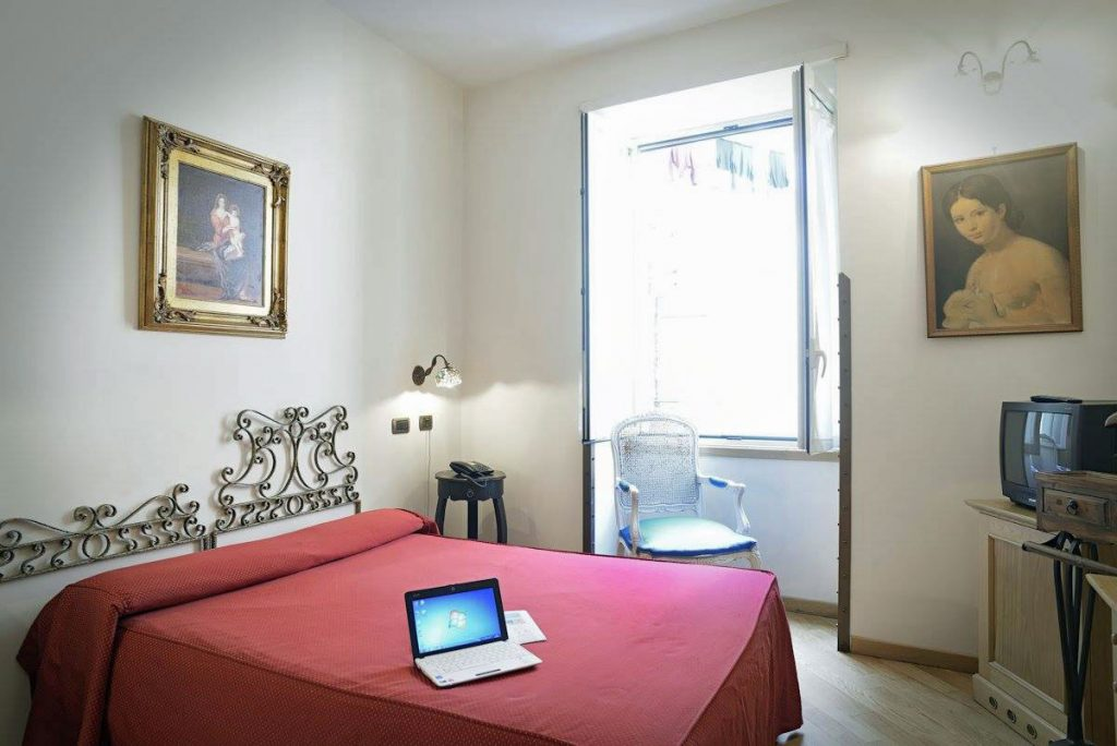 Guest room of Grand Hotel Europa Naples, italy